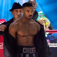 C2_01907_R2 (l-r.) Jacob 'Stitch' Duran as Stitch-Cutman, Sylvester Stallone as Rocky Balboa,  Michael B. Jordan as Adonis Creed  and Wood Harris as Tony 'Little Duke' Burton in CREED II,  a Metro Goldwyn Mayer Pictures and Warner Bros. Pictures film. Credit: Barry Wetcher / Metro Goldwyn Mayer Pictures / Warner Bros. Pictures © 2018 Metro-Goldwyn-Mayer Pictures Inc. and Warner Bros. Entertainment Inc. All Rights Reserved.